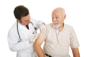 senior man taking a vaccine from his doctor