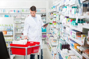 male pharmacist in the pharmacy