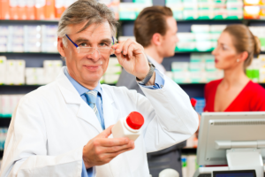 pharmacist holding a jar of medicines